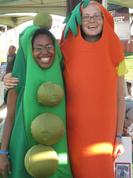 Meredith and Amelia wearing pea and carrot costumes!