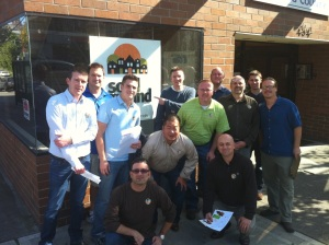 Execs and Penny Harvest staff pose outside Solid Ground