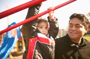 Andrew & his dad Hugo play together on the jungle gym