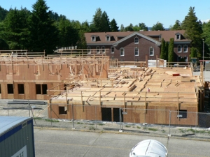 Building 5 takes shape south of the long barracks building on Sand Point Way.
