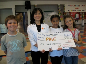 Adams Elementary check presentation to PAWS