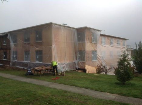 South side of Santos Place with protective plastic wrap