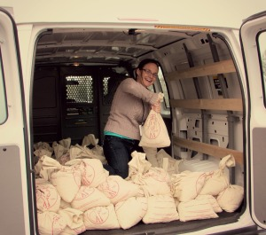 Kathleen Penna in a van full of sacks