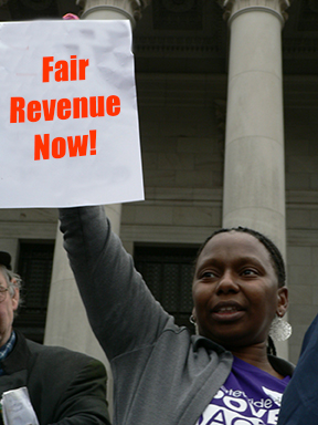 Protester calls for fair revenue in Olympia