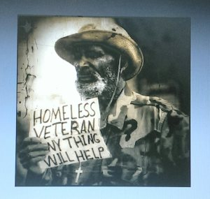 Homeless vet holding sign asking for help