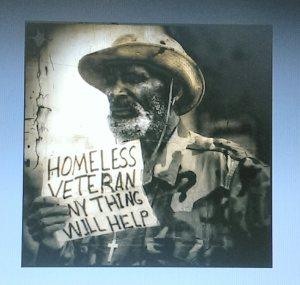 Homeless vet holding sign asking for help
